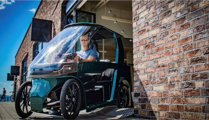 foto of CityQ quad velomobile rear seat with`weather protected passenger and cargo space, generator driven no chain