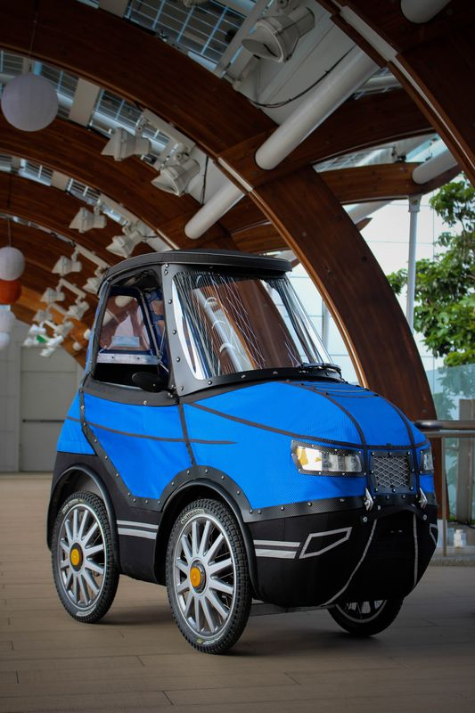 foto of podride velomobile with textile cover 4-wheeler e-bike car optic with rear seat in winter