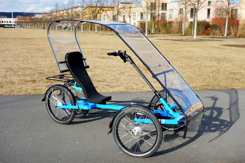 foto of ZOXBikes ZOX 4 quad velomobile with roof weather protection and cargo / plus option with rear seat or cargo box epac eva pedelec quadracycle